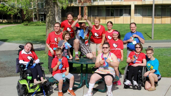 LansingStrong, a group of physically-impaired athletes, will compete in the annual Michigan Victory Games this weekend on the campus of Michigan State University. Pictured is last year's first-place team.