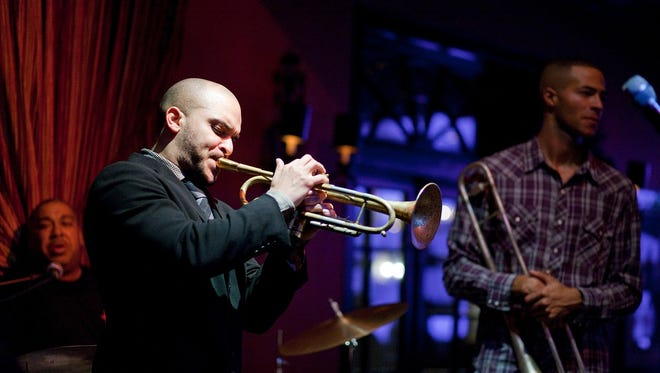 Trumpeter Irvin Mayfield charged the city's public library charity more than $18,000 to stay five nights at a hotel in New York's Central Park in July 2012, according to invoices provided by the New Orleans Public Library Foundation.