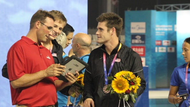 Purdue and U.S. Olympic Diving coach Adam Soldati with Steele Johnson and David Boudia