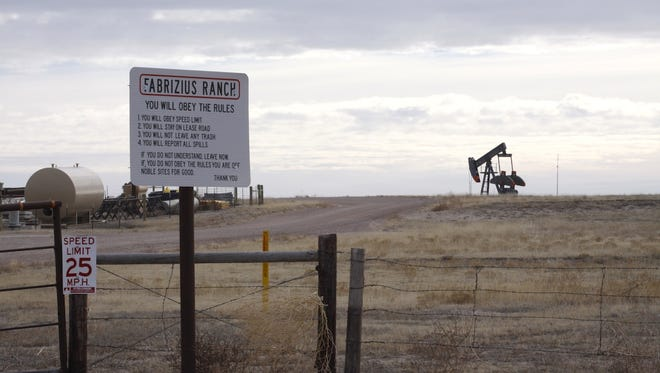 A Noble Energy sign warns truck drivers to slow down on the Fabrizius Ranch outside Grover. Noble operates two dozen oil and gas wells on the site proposed for Galeton Reservoir in Weld County.