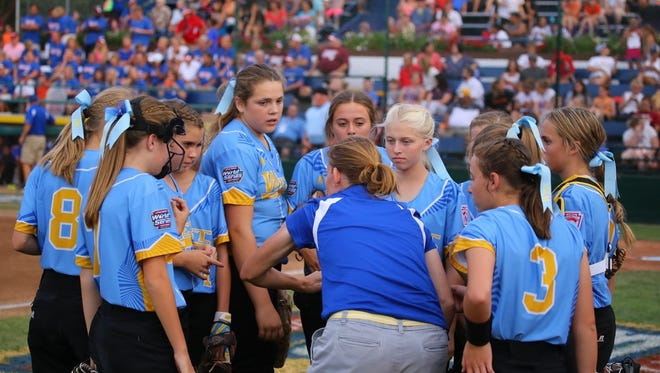 Snow Canyon players and coaches talk Monday in the quarterfinal game of the Little League World Series in Portland, Oregon. SC was eliminated in a 10-0 loss and had a 2-3 overall record in the tournament.