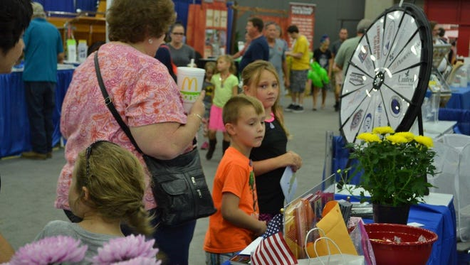A dozen Union County businesses donated giveaways for Union County's booth at the State Fair.  A spinning wheel was used to see what prize each  visitor received.  The wheel proved to be very   popular and attracted much attention to our booth.