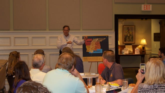 """Aubrey Preston explains  the """"Americana Music Triangle"""" to the audience Friday at First United Methodist Church."""
