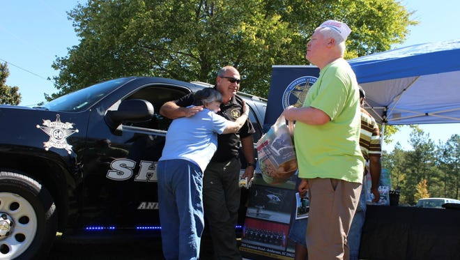 Haven of Rest Ministries looks forward to Appreciation Day each year. Lloyd Robinson of the Anderson County Sheriff's Office is shown in background.