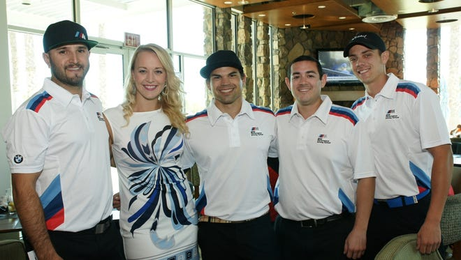 First Place Winners of the Tourney:  BMW Performance Center pictured left to right  Andy Garza, Julie Buehler, MC, Bradley Strzelczyk, Michael Pena, and David Carlin.