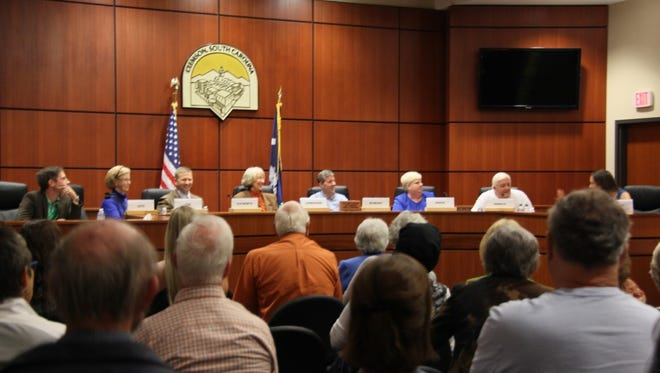 Clemson City Council candidates, from left, Mark Cato, Crossie Cox, John Ducworth, Eunice Lehmacher, Drake McNeary, Christine Minor and Jim Oswald discuss issues facing the city during a forum Tuesday night at City Hall.