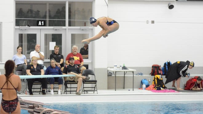 Hallie Roman dives at the Division 1 regional meet at Bloomfield Hills.