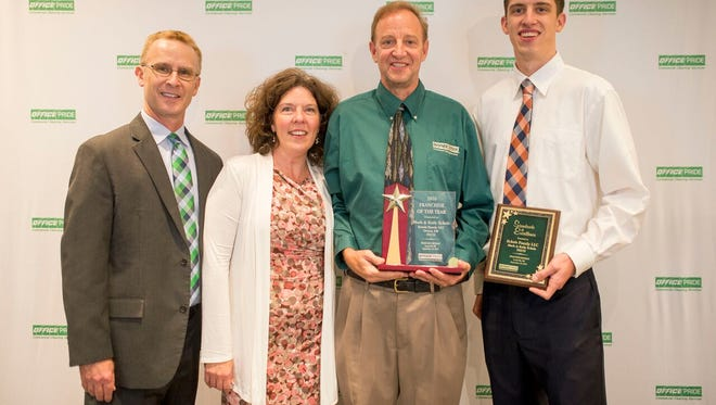 Mark and Kelly Eckles (center) received two awards from Office Pride.