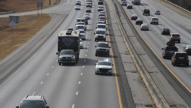 The funeral procession for a fallen U.S. marshal passes through Interstate 85 in Anderson County, approaching exit 40 northbound, on Sunday afternoon on its way to Virginia.