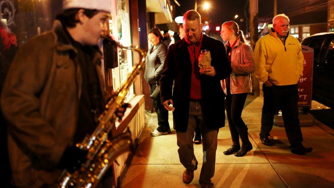 Weston Sharpensteen, 17, provided a holiday soundtrack to passersby during the 31st annual Bardstown Road aglow in the Highlands neighborhood. December 3, 2016Tyler Bissmeyer/Special to The C-J