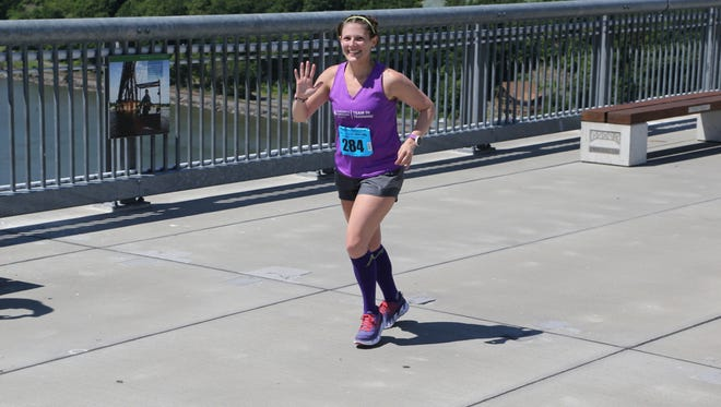 Tiffany Sivco, a Wappingers Falls resident, runs in the Walkway Marathon on the Walkway Over the Hudson.