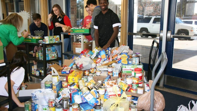 Seneca Middle School students have fun sorting canned food drive donations.