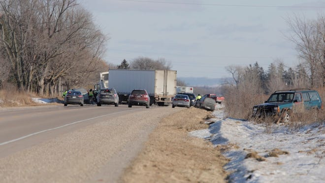 A semitrailer blocks State Highway 21, shortly before 1 p.m. Wednesday, about  1/2 mile east of Sand Pit Road in the town of Omro.