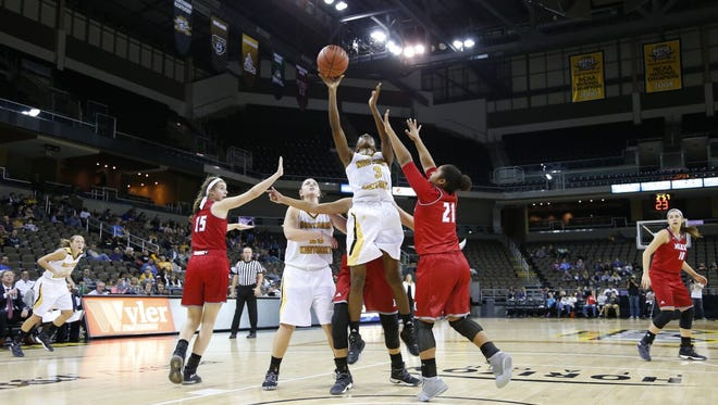 The Norse's Rebecca Lyttle goes strong to the basket.