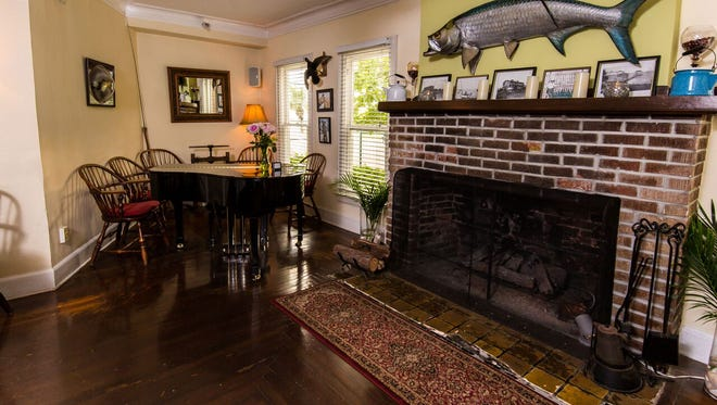 The Tarpon Lodge still has its original 1926 flooring and fireplace.