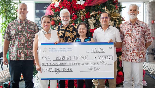 The Andrea R. Ilao Foundation recently donated the proceeds from the raffle at the Red Ball fundraising gala to the Guam Chapter of the American Red Cross. From left, Jay Jones, Triple J Enterprises senior vice president; Chita Blaise, chief executive officer of the Guam chapter of the American Red Cross; Jeff Cook, Red Cross board member; Elizabeth Oriondo, Andrea R. Ilao Foundation corporate treasurer; Ed Ilao, Andrea R. Ilao Foundation president/chairman; and Jeff Jones, Triple J Enterprises president and chief operating officer.