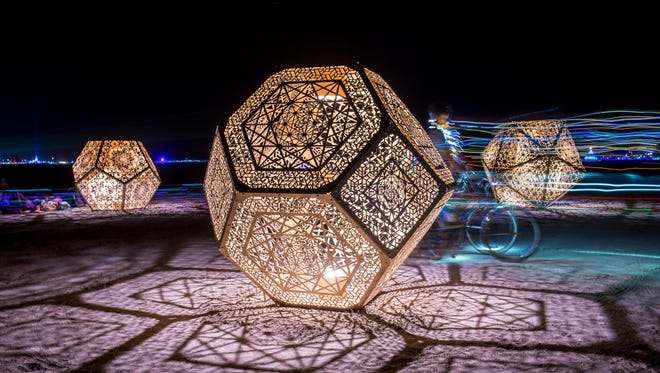 """Find """"HYBYCOZO"""" by Yelena Filipchuk and Serge Beaulieu at Scottsdale's Canal Convergence Feb. 23-26.  These three sculptures are 7-foot tall polyhedrons,  inspired by natural forms, ancient Islamic tiles, mathematics and geometry that are lit with LEDs from the inside."""
