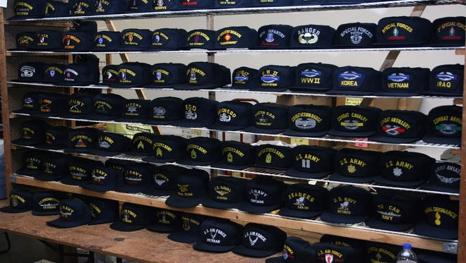 Hats from all branches of service were on display at the 30th annual Tet Reunion.