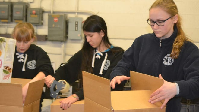 St. Hugo students recently took part in a day of service.