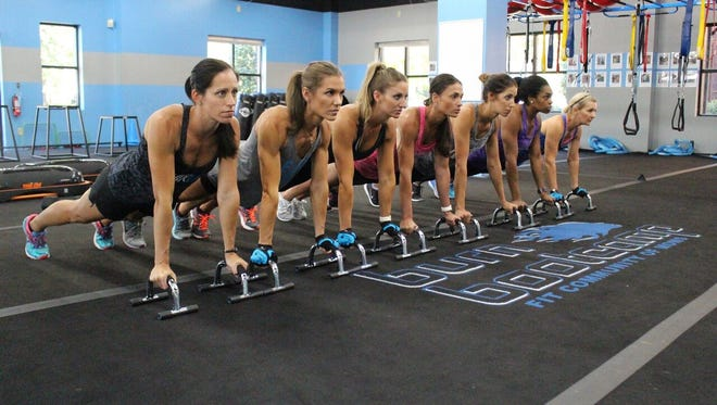Women in workout formation at a Burn Boot Camp location.
