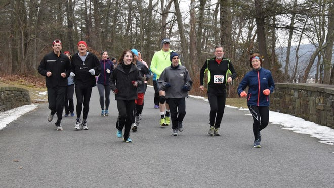 Runners take part in the annual Recover from the Holidays event in 2016, one of the main local running events for the winter months.