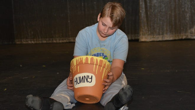 """Winnie the Pooh (Garrett McGillis, pictured) and his friends search for Christopher Robin (Dawson Dabovich) in """"Winnie the Pooh Kids,"""" opening March 4 at the Wichita Theatre."""