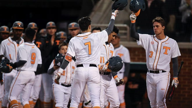 Jordan Rodgers of Tennessee, left, tips his helmet to Andre Lipcius in the third inning after Rodgers slugged the first of two home runs on Friday. The Vols beat Norfolk State 10-2 at Lindsey Nelson Stadium.