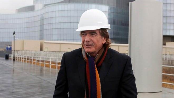 In this file photo, Glenn Straub stands outside the Revel casino-hotel in Atlantic City. Since buying Atlantic City's former Revel casino two years ago, Straub has resisted following rules that bind all his would-be competitors. Even as he blames city and state officials for red tape that has so far prevented him from reopening the star-crossed resort under the new name Ten, Straub's struggles have left him with an empty building and piles of legal bills.