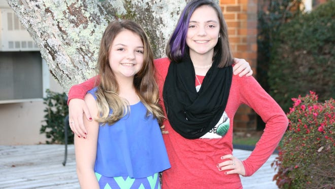 Shown are sisters Hannah and Kaileigh Brinkley who have won the Spelling Bee and Geography Bee at Seneca Middle School.