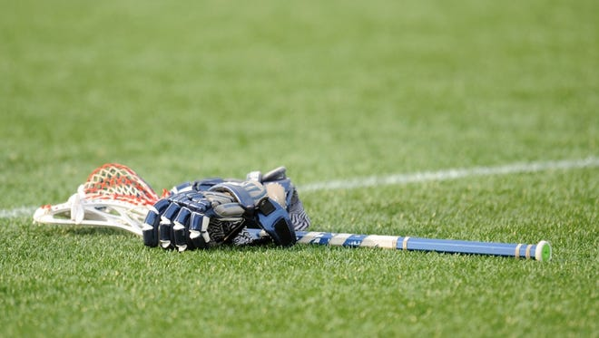 A lacrosse stick and gloves.