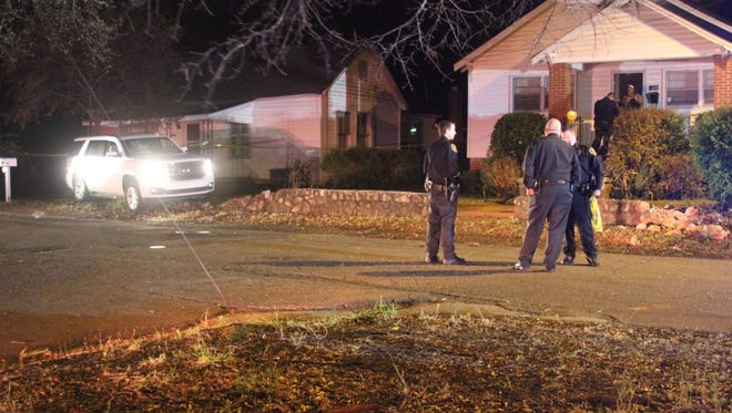 Anderson Police Department officer investigate the scene of a fatal shooting Saturday night at High and Thomas streets.