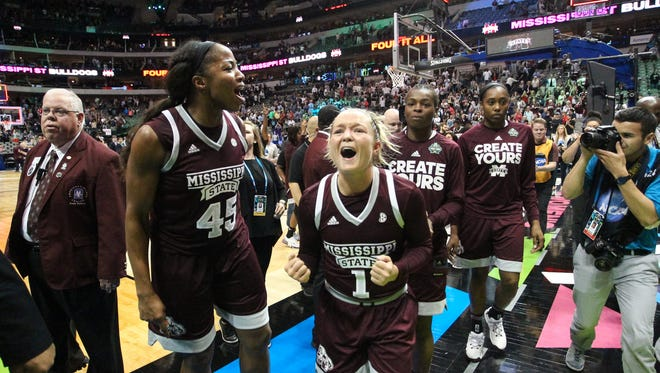 Mississippi State's Blair Schaefer (1) and Mississippi State's Chinwe Okorie (45) celebrate after defeating UConn. Mississippi State played UConn in the semifinal game of the NCAA Women's Final Four in Dallas on Friday, March 31, 2017. Photo by Keith Warren(Mandatory photo credit)
