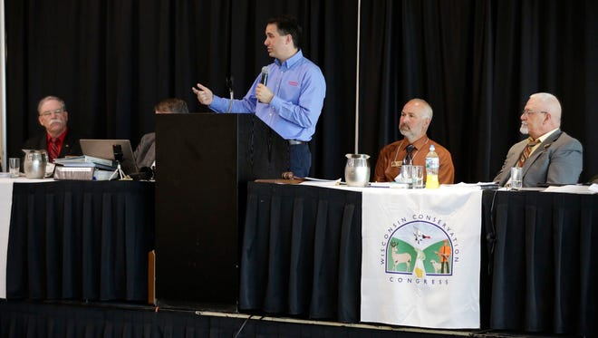 Gov. Scott Walker speaks to a crowd at the annual convention for the Wisconsin Conservation Congress Friday at the Best Western Premier Waterfront Hotel and Convention Center in Oshkosh.