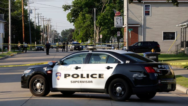 Oshkosh police block off an area from Fourth to Seventh avenues, between Idaho and Knapp streets on Monday, July 31, 2017.