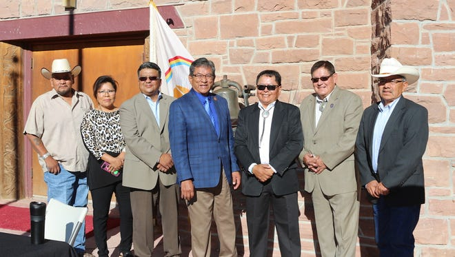 Thomas J. Holgate, third from right, stands with tribal leaders during his swearing-in ceremony on Tuesday in Window Rock, Ariz.