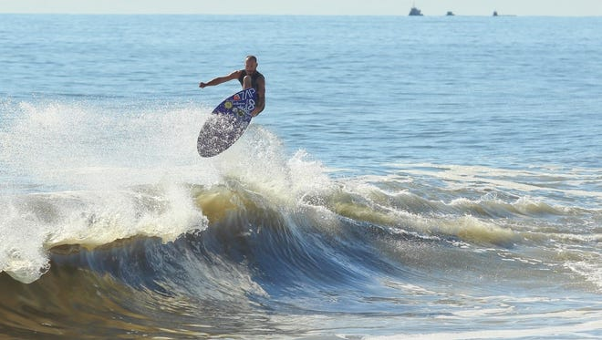 Jason Wilson rides a wave on his skimboard. Wilson grew up in Dewey Beach, which is regarded as one of the best skimboarding areas in the world.