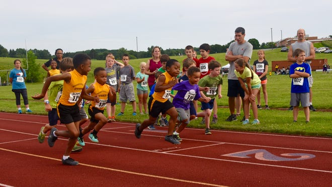 Young runners take part in the Mid-Hudson Road Runners Club's Summer Twilight Track Series on July 28.