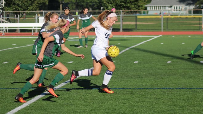 Senior Kayla Afflitto, right, is one of seven seniors back on the Pequannock High School girls' soccer team this fall.