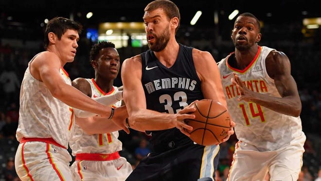 Grizzlies center Marc Gasol (33) controls the ball against the Atlanta Hawks' Ersan Ilyasova (7), Dennis Schroder (17) and Dewayne Dedmon (14) during the first half Oct 9, 2017.