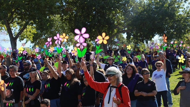 The Walk to End Alzheimer's drew more than 500 participants to Young Park.