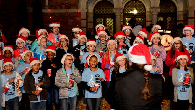 Fourth- and fifth- graders from Ben Franklin Elementary sing Monday night, helping to usher in the start of the MSU-Burns Fantasy of Lights season.