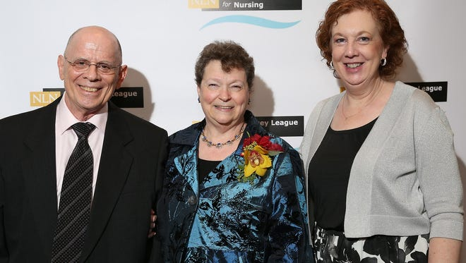 Beryl Stetson, professor of Nursing at Raritan Valley Community College (center), a recipient of the 2017 NJLN Nurse Recognition Award, celebrates at the Nov. 3 NJLN Nurse Recognition Awards Gala with her husband, Elliott Stetson, RVCC associate professor of Nursing, and Dr. Deborah E. Preston, RVCC provost and vice president of Academic Affairs.