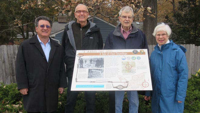 At the post dedication are (from left) Steve Stone, of Stone Soap Co.; Eric Wiegand; John Marshall and Helen Peters. Wiegand, Marshall and Peters collaborated on the design of the sign.