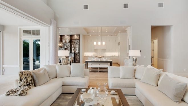 Clive Daniel Home has completed a custom home for Belz Properties at 594 Yucca Road in Coquina Sands.