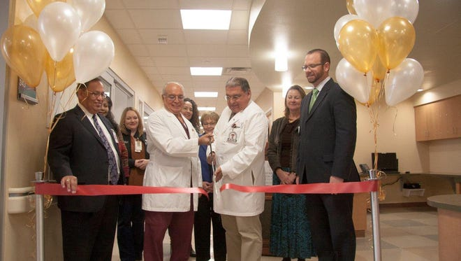 (from left to right) Jacob Cintron, President & CEO; Dr. Luis Vasquez, Medical Director of Neurosurgery; Dr. Salvador Cruz-Flores; and Commissioner David Stout, cut the ribbon on the new unit, flanked by department and UMC leadership.