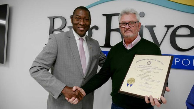 Kentucky Labor Cabinet Secretary Derrick Ramsey presents Big Rivers' second Governor's Safety and Health Award.