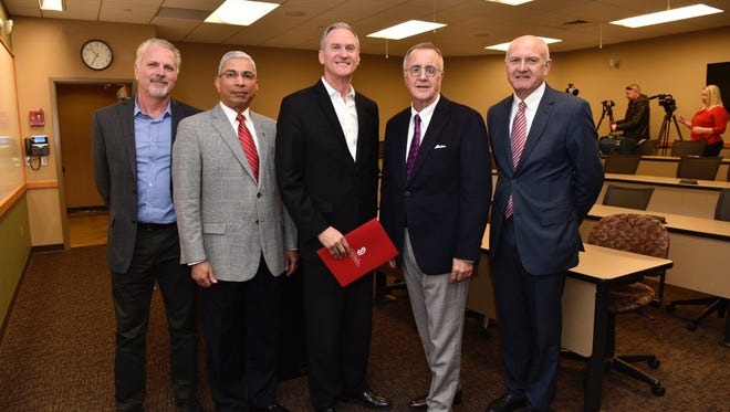 From left to right - Greg Bertsch, president and CEO of Antimicrobial Materials, Inc., Venky Venkatachalam, dean of the Beacom School of Business, South Dakota Governor Dennis Daugaard, USD President James W. Abbott, Mel Ustad Director of Commercialization State of South Dakota. All men were present at an announcement Wednesday, Dec. 20, 2017 about a new Proof of Concept program at USD.