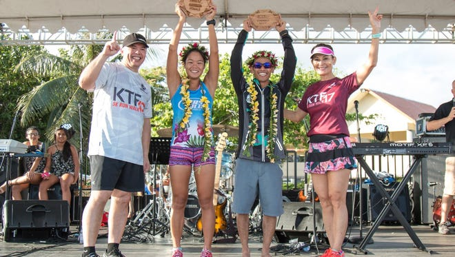 From left, Pay-Less General Manager Mike Benito with 2017 top female finisher Manami Iijima, 2017 top male finisher Ryan Matienzo and Pay-Less Executive Vice President Kathy Sgro.