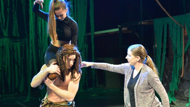 """""""Tarzan: the Stage Musical"""" choreographer Stephanie Medenwaldt works with Tarzan (Bryson Petersen) and the leopard (Baxter Swint) on a fight scene for the new production of the musical which opens at 7:30 p.m. tonight at the Wichita Theatre."""