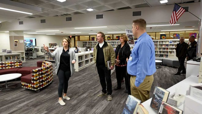 Isabel Koepp, Menomonee Falls High School senior and business academy student, provides a tour to community members during the VIP Tour of new high school facilities this month.